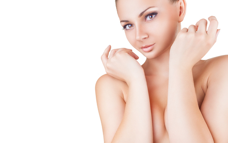 nude breast: Beautiful young woman with clean skin covering her nude breast isolated on white background
