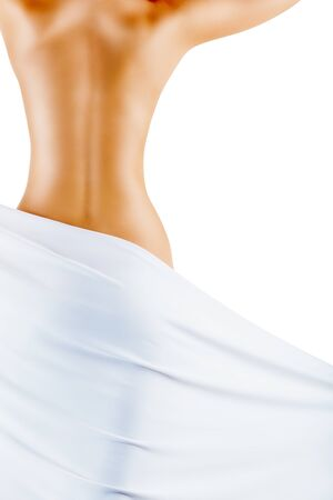 woman naked body: Well-groomed back of a young woman with a towel isolated on a white background Stock Photo