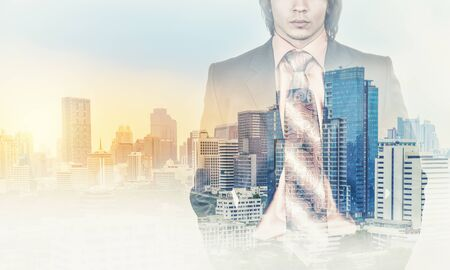 megacity: Double Exposure of a businessman in a suit and a megacity