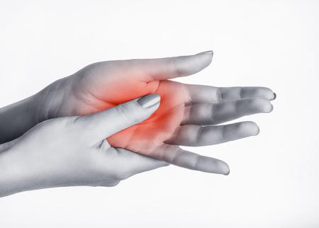 dolor: Una mujer da masajes a su lado doloroso aislado en un fondo blanco Foto de archivo