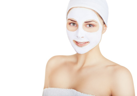 Portrait of a beautiful young woman with a white mask on his face. Isolated on white background