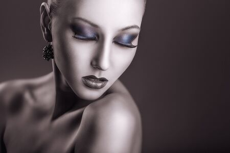 woman black background: Portrait of a young woman with fashion makeup on a dark background