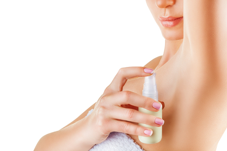 adult armpit: Close up of woman applying deodorant on underarm isolated on a white background