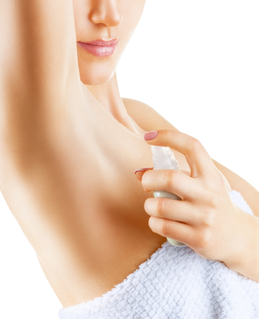 hygenic: Close up of woman applying deodorant on underarm isolated on a white background