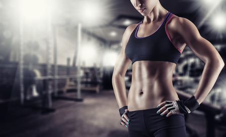 Young beautiful athlete woman in the gym Stock Photo - 61459149
