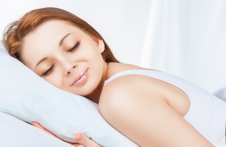 attractive woman: Young attractive woman sleeping in her bed Stock Photo