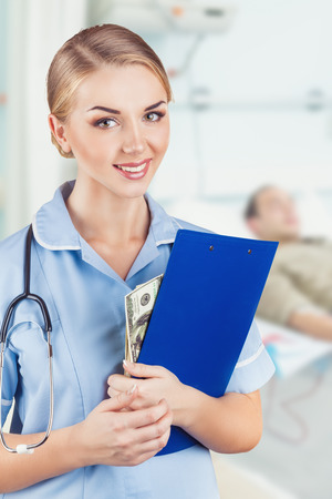 Woman doctor putting bribe into her clipboard