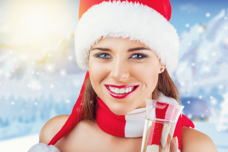 christmas hat: Portrait of beautiful young christmas woman with santas hat and glass of champagne Stock Photo