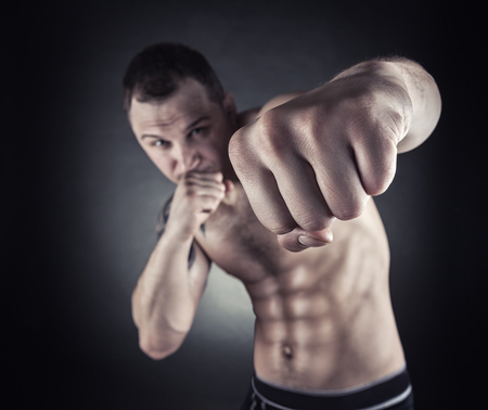 Boxing concept. Closeup boxer fist. Focus on the hand Stock Photo