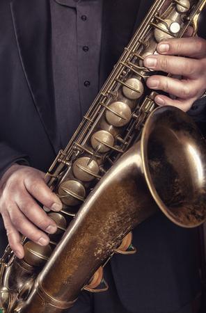 Saxophone player jazz music instrument. Alto sax musical instrument closeup Stock Photo