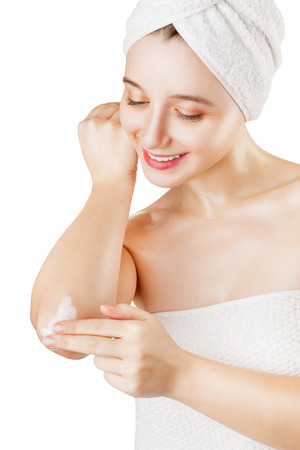 Close-up of a woman takes care of his elbows using cosmetic cream isolated on a white background 版權商用圖片