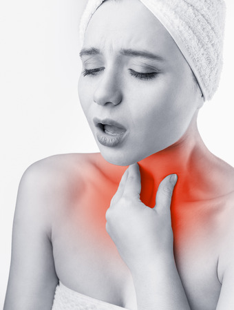 Woman holding his throat in pain. Medical concept.