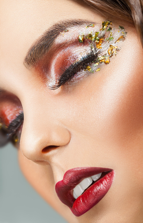 Fashion Makeup. Close-up face of a beautiful sexy woman with fashion makeup. Closed eyes Stock Photo