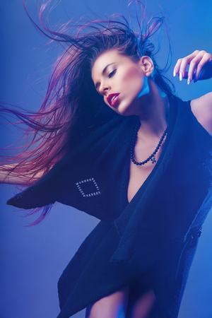 Red-hair girl with long waving hair. Fashion photo