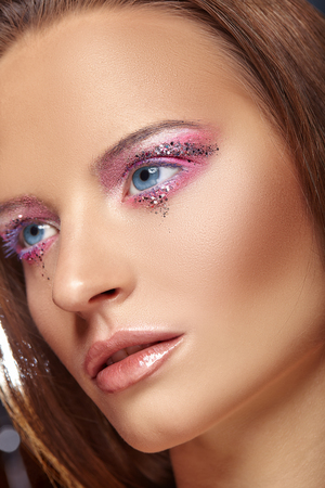Gentle makeup. Close-up face of a beautiful young woman with fashion make-up Stock Photo