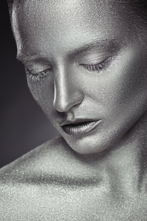 Fashion makeup. Close-up of a young woman with silver makeup with  sequins