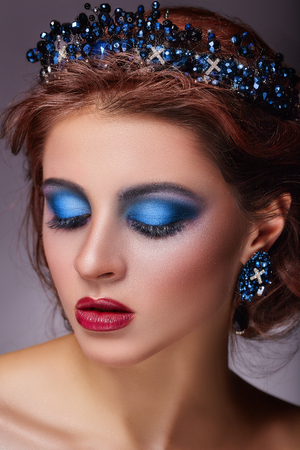 Portrait of beautiful woman with fashion makeup and a tiara in her hair