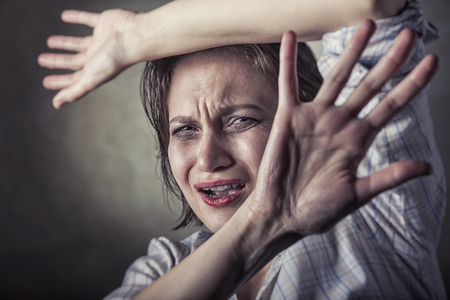 Close up view of young woman making stop gesture with her hand. Focus on the face Stock Photo