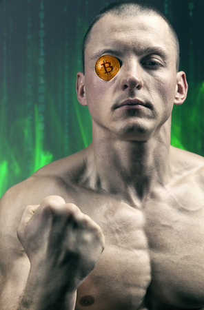 Portrait of a strong muscular man with a bitcoin instead of an eye. Digital symbol of a new virtual currency