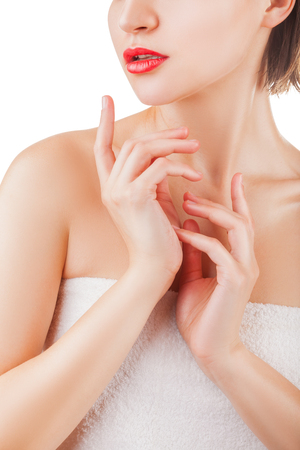 Beauty and healthy concept. Close-up of young girl caring for her face and body on a light background Stock Photo