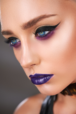Close-up portrait of young woman with smokey eyes. Modern fashion make-up. Studio shot Standard-Bild - 123219442