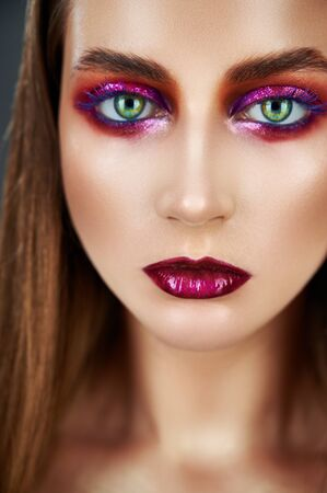 Evening make-up. Portrait of young beautiful woman with long hair and bright evening make-up Standard-Bild - 125853749