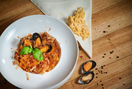 Pasta with seafood. Tagliatelle with mussels