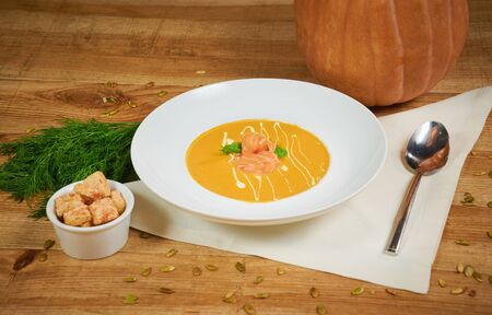 Pumpkin soup with sliced salmon