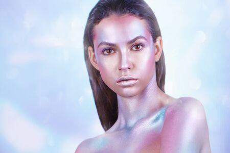 Fashion model woman with trendy metallic make-up. Glitter vivid makeup. Fashion makeup
