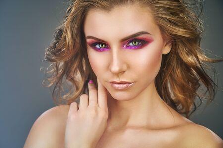 Fashion makeup. Beauty fashion model girl. Beautiful model girl with pink fuchsia makeup