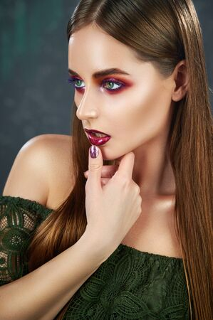 Evening makeup. Portrait of young beautiful woman with long hair and bright evening makeup