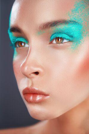 Woman with fashion makeup and green eye shadows. Fashion makeup Standard-Bild