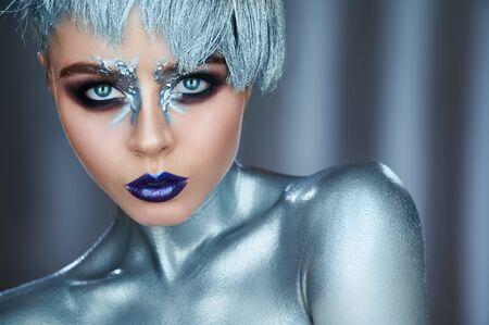Fashion model woman with trendy metallic make-up.