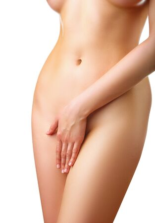 Part of a nude woman body with close hand between the legs isolated on white background