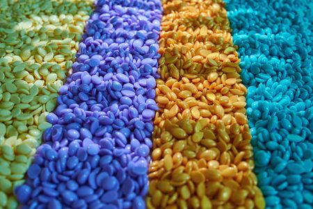 Granules for depilation. Abstract beautiful backdrop. Wallpaper. Granules for hair removal. Colorful wax granules