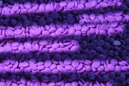 Abstract beautiful backdrop. Wallpaper. Granules for hair removal. Purple wax granules