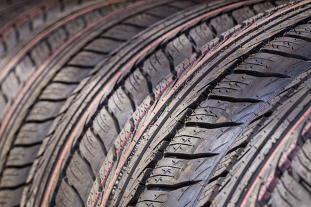 Car tires in a row. Selective focus (close up) Stock Photo