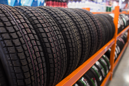 New winter studded tire sold in the shop Stock Photo