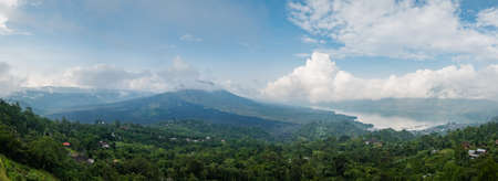 Wide panorama of Mount Batur or Gunung Batur, an active volcano located at the center of caldera and Mount Agung which dominates the surrounding area on the island of Bali, Indonesia
