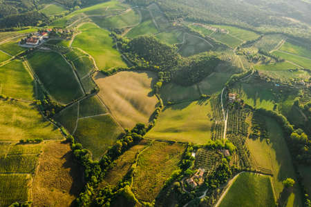 Beautiful morning Tuscany landscape in May. Green panoramic perspective hills and fields. Toscana, Italy, Europe.