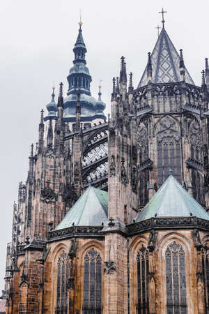 St. Vitus is a Roman Catholic cathedral situated in the Prague Castle complex, and the seat of the Archbishop, Czech Republic. Beautigul architecture in Gothic style. Vertical shot.