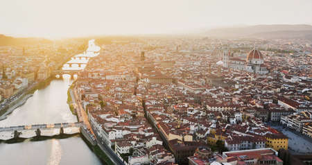 Piazzale Michelangelo view Florence Italy. Beautiful panoramic aerial shot of the city Florence, Tuscany, Italy. Buildings, cathedrals, and mountains with bridges on the sunset. High resolution. Stok Fotoğraf
