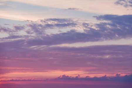 Beautiful sunrise sky with clouds and early sun. Structure and texture. Sunset. Nature landscape at the morning. Meditation and relaxation. Abstract background and horizon.