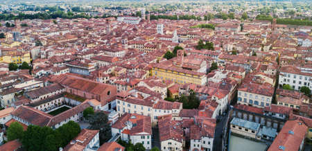 Landmarks of Italy - medieval town Lucca in Tuscany. Aerial view to the city. Buildings with tiled roofs. Beautiful landscape and cityscape. Postcard Italian concept. Tower and historical houses.
