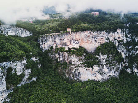 Aerial view by drone of Madonna della Corona Sanctuary church, Italy. Amazing beautiful italian place and landscape. Historical and medieval building in the rock and mountain. Postcard concept. Stok Fotoğraf