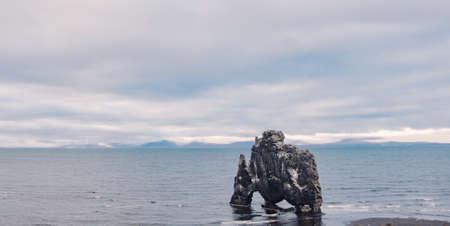 Hvitserkur basalt mountain rock on the east coast in Iceland. Peninsula Vatnsnes. Beautiful nature scandian landscape. Travel icelandic destination. Postcard concept.