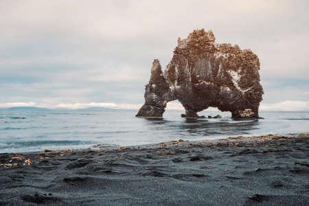 Hvitserkur basalt mountain rock on the east coast in Iceland. Peninsula Vatnsnes. Beautiful nature scandian landscape. Travel icelandic destination. Postcard concept. Standard-Bild