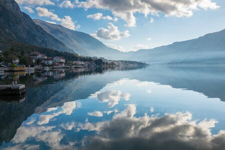 mediterranian: Reflection of clouds with mountains background Stock Photo