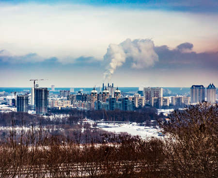 General city landscape with poisoned emissions from plant. Kiev general cityscape , with trees on the first plan. Left coast of Kiev city Stock Photo