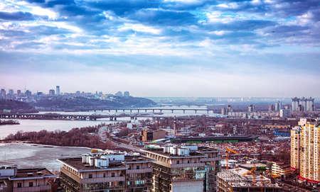 Landscape scene on Dniper riverm through buildings of Kyiv